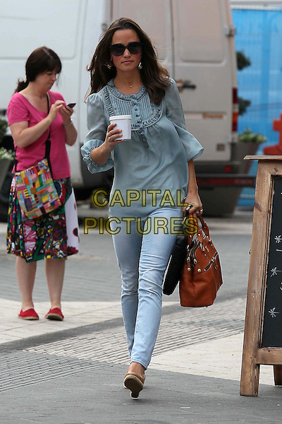 Pippa MIddleton spotted Chelsea, London, England..September 2nd, 2011.full length blue top sheer sunglasses shades jeans denim cup walking tan brown bag purse  .CAP/HIL.©John Hillcoat/Capital Pictures .