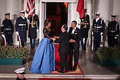 United States President Barack Obama and first lady Michelle Obama welcome President Francois Hollande of France on the North Portico of the White House before the State Dinner in Hollande's honor in Washington, District of Columbia, U.S., on Tuesday, Feb. 11, 2014.  After an arrival ceremony on the South Lawn, Obama and Hollande met in the Oval Office for a policy meeting then gave a joint press conference in the East Room of the White House. <br /> Credit: Pete Marovich / Pool via CNP<br /> Credit: Pete Marovich / Pool via CNP