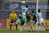 #11 Cristiane of the Chicago Reds tries a header on goal against the defense of St. Louis Athletica. Athletica beat the Red Stars 2-0...