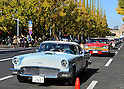 November 27, 2011, Tokyo, Japan - A 1957 Ford Thunderbird is followed by a 1957 Plymouth Fury during the fifth Classic Car Festa 2011 in Tokyo on Sunday, November 27, 2011. Some 43,000 spectators watch about 100 domestic and foreign classic and vintage cars parade the gingko-lined streets of the Meiji Shrines Outer Garden in the annual open-air exhibition and parade sponsored by Toyota Automobile Museum. (Photo by Natsuki Sakai/AFLO) [3615] -mis-