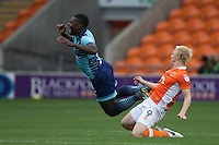 Aaron Pierre of Wycombe Wanderers is fouled by Mark Cullen of Blackpool during the Sky Bet League 2 match between Blackpool and Wycombe Wanderers at Bloomfield Road, Blackpool, England on 20 August 2016. Photo by James Williamson / PRiME Media Images.