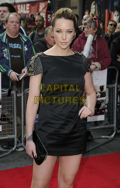 Emily Scott.The 'Klitschko' UK film premiere, Empire cinema, Leicester Square, London, England..May 21st, 2012.half length black dress hand on hip clutch bag.CAP/CAN.©Can Nguyen/Capital Pictures.