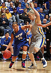 SIOUX FALLS, SD - MARCH 11:  Haley Seibert #10 from IPFW drives against Mariah Clarin #40 from South Dakota State in the second half of their semifinal game Monday afternoon at the 2013 Summit League Tournament in Sioux Falls, SD.  (Photo by Dave Eggen/Inertia)