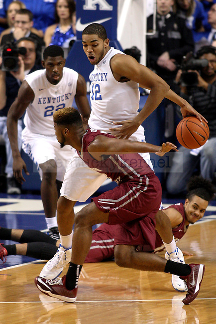 December 7, 2014- Kentucky Wildcats forward Karl-Anthony Towns (12) dribbles the ball around his back to drive up the court against EKU guard Jonathan Hood (23) during the first half at Rupp Arena. Kentucky defeated Eastern Kentucky 82-49. Photo by Tessa Lighty | Staff