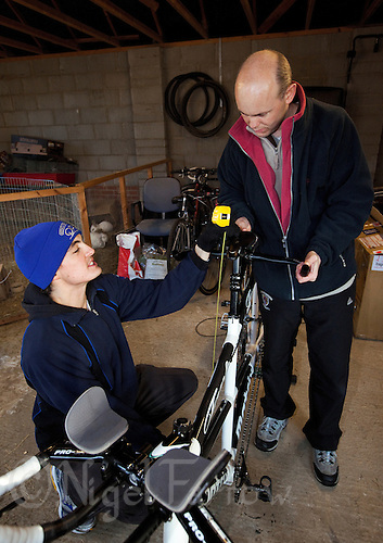 10 DEC 2011 - NORFOLK, GBR - Iain Dawson (right) sets up the seat on the new tandem for his guide Luke Watson (left) .(PHOTO (C) NIGEL FARROW)