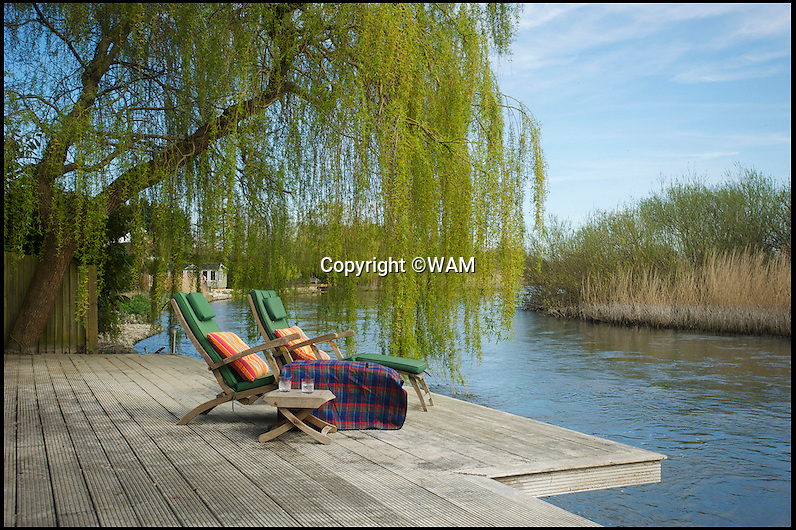 BNPS.co.uk (01202 558833)Pic: WAM/BNPS<br /> <br /> The home borders the river Avon near Ringwood in Hampshire.<br /> <br /> How's your luck? - Stunning £3 million Huf Haus could be yours for only £25.<br /> <br /> A lucky winner will get a stunning £3m house for just £25, it has been revealed today.<br /> <br /> Avon Place, a stylish and contemporary six-bedroom mega home, is located in the picturesque Avon Castle estate near Ringwood in Hampshire.<br /> <br /> Premiership star Adam Lallana would be a neighbour for the lucky winner of the ultra modern riverside home.<br /> <br /> The height of luxury, the property - which includes a a cinema and a snooker room - has previously been valued at £2,995,000 but now is being sold as the prize in a high-end raffle, with tickets costing just £25 each.