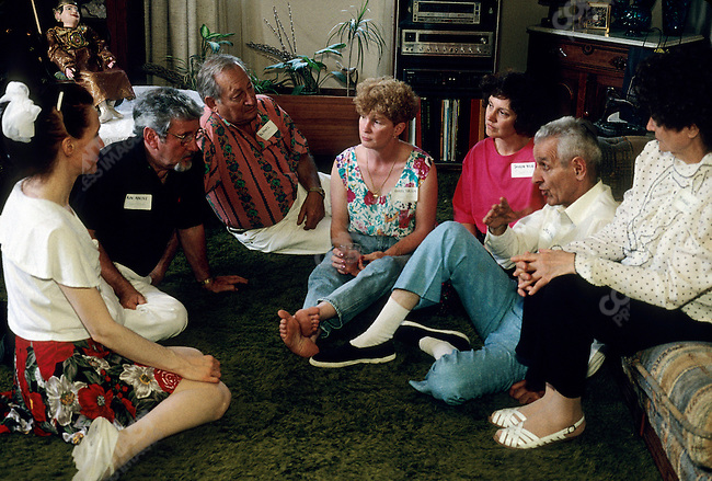 """Jack Kevorkian, MD, so called """"Dr Death"""" as a renowned advocate for assisted suicide in the early 1990s, takes a break with members if the Adkins, Wants and Miller families (who all had loved ones assisted to euthanasia by Kevorkian) during a picnic organized by some of the families in gratitude to Dr Kevorkian. Detroit, Michigan, June 1992"""