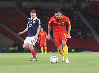 Ivan Trichkovski watched by James Forrest in the Scotland v Macedonia FIFA World Cup Qualifying match at Hampden Park, Glasgow on 11.9.12.