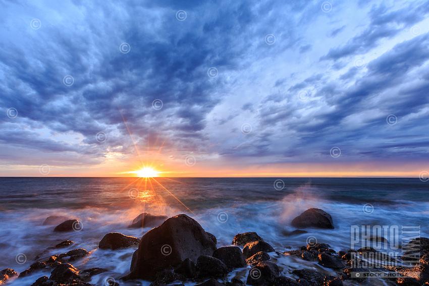 A dramatic sunset at Ke'e Beach, Ha'ena State Park, Na Pali Coast, Kaua'i.