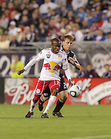 New York Red Bulls forward Dane Richards (19) and New England Revolution defender Seth Sinovic (27) close on a loose ball. The New England Revolution defeated the New York Red Bulls, 3-2, at Gillette Stadium on May 29, 2010.