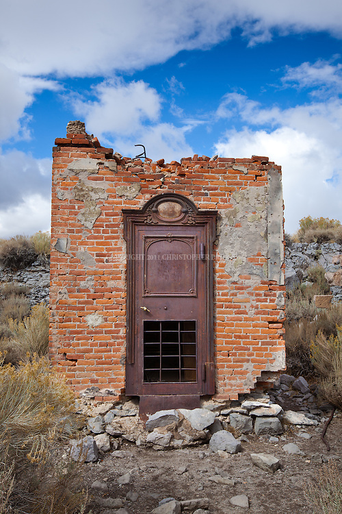 Site of Bodie Bank, destroyed by fire in 1932. One of fewer than 170 structures remaining in the ghost town of Bodie; gold discovered here in 1859. Designated National Historic Landmark in 1961; 1962 it became Bodie State Historic Park. Bodie named California's official state gold rush ghost town. Historic District, California State Park. Mono County, CA.