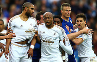 Players grapple at a corner kick during the Barclays Premier League match between Leicester City and Swansea City played at The King Power Stadium, Leicester on 24th April 2016