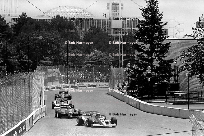 TORONTO, ON - JULY 20: Rick Mears drives his Roger Penske March 86C/Cosworth ahead of Tom Sneva and others during the Molson Indy Toronto CART Indy Car race on the temporary street circuit at Exhibition Place in Toronto, Ontario, Canada, on July 20, 1986.