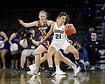SIOUX FALLS, SD - MARCH 8: Rylie Torrey #21 of the Oral Roberts Golden Eagles pivots and drives to the basket against Sam Pryor #34 of the Western Illinois Leathernecks at the 2020 Summit League Basketball Championship in Sioux Falls, SD. (Photo by Richard Carlson/Inertia)