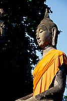 Buddha statue draped with orange sash, Ayuthaya, Thailand