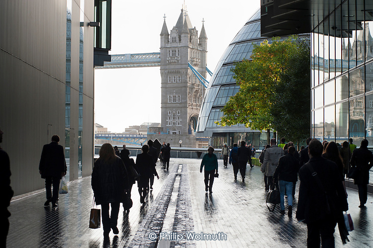 Commuters arrive for work at offices in the More London complex, close to Tower Bridge