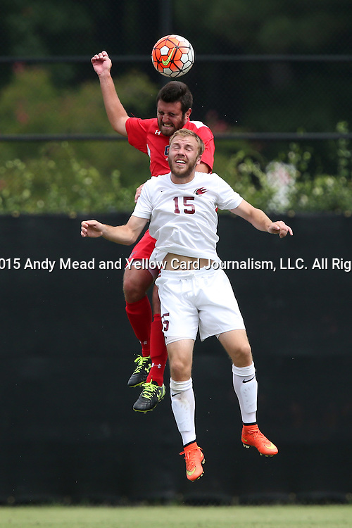 30 August 2015: Saint Mary's Forrest Solis (behind) heads the ball over Elon's Cooper Vandermaas-Peeler (15). The Elon University Phoenix played the Saint Mary's College Gaels at Koskinen Stadium in Durham, NC in a 2015 NCAA Division I Men's Soccer match. Elon won the game 1-0.