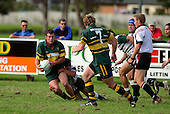 B. Farrell has J. Maher in support as he is brought to ground. Counties Manukau Premier Club Rugby, Pukekohe v Manurewa  played at the Colin Lawrie field, on the 17th of April 2006. Manurewa won 20 - 18.