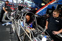 Nov 7, 2013; Pomona, CA, USA; Crew members for NHRA top fuel dragster driver Antron Brown during qualifying for the Auto Club Finals at Auto Club Raceway at Pomona. Mandatory Credit: Mark J. Rebilas-