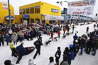 Saturday March 6 , 2010   Rookie musher Pat Moon's team is walked to the start line on 4th avenue in downtown Anchorage during the ceremonial start of the 2010 Iditarod in Anchorage , Alaska