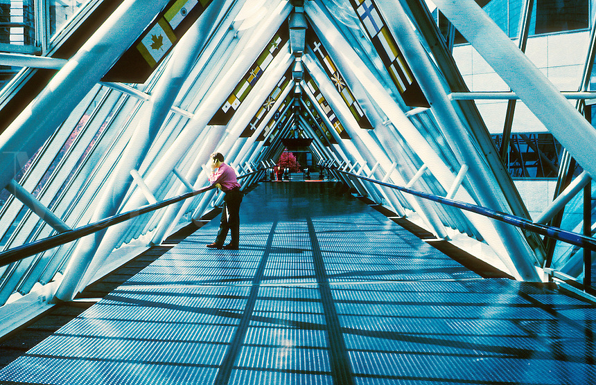 man stands on triangular bridge talking on phone, communication, modern interior architecture, telecommunications. business man. Oregon, World Trade Center.