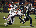 Seattle Seahawks running back Thomas Rawls runs though the tackle of Denver Broncos safety Josh Furman (41) during the fourth quarter at CenturyLink Field on August 14, 2015 in Seattle Washington.  Rawls run for a touchdown on a 19-yard pass from quarterback A.J. Archer. The Broncos beat the Seahawks 22-20.  © 2015. Jim Bryant Photo. All Rights Reserved.