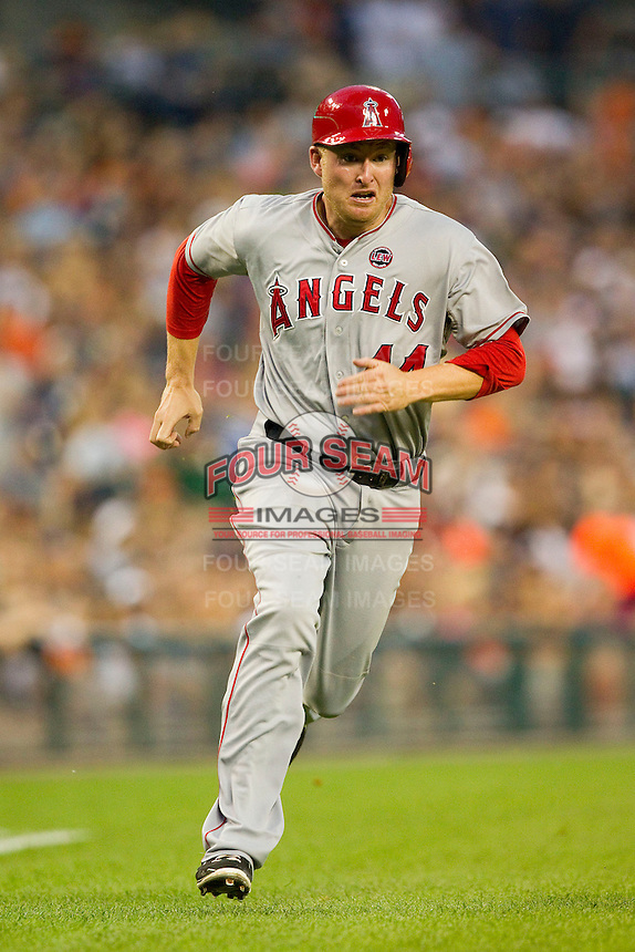 Mark Trumbo (44) of the Los Angeles Angels hustles down the third base line on his way to scoring a run against the Detroit Tigers at Comerica Park on June 25, 2013 in Detroit, Michigan.  The Angels defeated the Tigers 14-8.  (Brian Westerholt/Four Seam Images)