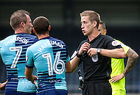 Referee John Brooks brandishes another yellow card during the Sky Bet League 2 match between Wycombe Wanderers and Colchester United at Adams Park, High Wycombe, England on 27 August 2016. Photo by Liam McAvoy.