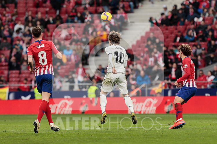 Atletico de Madrid's Saul Niguez (L) and Antoine Griezmann (R) and Real Madrid's Luka Modric during La Liga match between Atletico de Madrid and Real Madrid at Wanda Metropolitano Stadium in Madrid, Spain. February 09, 2019. (ALTERPHOTOS/A. Perez Meca)
