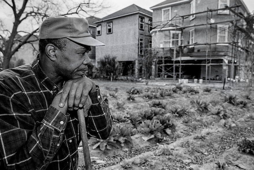 "Eddie Grant Jr. tends his mother's garden as new condominiums rise along her property line. While Grant's family has managed to hold onto their land, many other Gullah Geechee residents have been forced to sell their property due to rampant development and escalating taxes. Grant says Hilton Head has ""lost its charm"" to development."