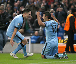 Wining goalscorer Sergio Aguero of Manchester City (r) celebrates with Samir Nasri of Manchester City - UEFA Champions League group E - Manchester City vs Bayern Munich - Etihad Stadium - Manchester - England - 25rd November 2014  - Picture Simon Bellis/Sportimage