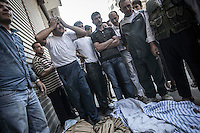 A Syrian civilian bawls bereaved as he cries out woeful in front of the dead bodies of his relatives loaned on the street, who were killed during an aircraft shelling carried out by Assad's air force.