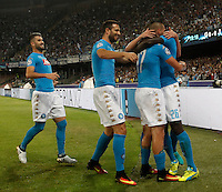 Calcio, Champions League Gruppo B: Napoli vs Benfica. Napoli, stadio San Paolo, 28 settembre 2016. <br /> Napoli's Marek Hamsik second from right, celebrates with teammates after scoring during the Champions League Group B soccer match between Napoli and Benfica at the Naples' San Paolo stadium, 28 September 2016. Napoli won 4-2.<br /> UPDATE IMAGES PRESS/Isabella Bonotto