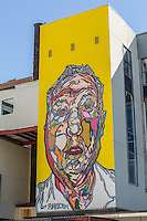 A contemporary wall mural by street artist Fumero on the side of the Herald Statesman building in Yonkers, New York.