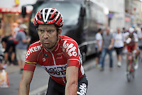 """""""I made it. Broken ribs. Bruised lung. 7 stitches in my hip. Add in a 225k stage and 7 sectors of pave. <br /> I suffered like a dog today for most of the 6hrs on the bike. <br /> However this is the Tour de France. They have to peel us from our bikes before we throw in the towel. """"<br /> Greg Henderson (NZL/Lotto-Soudal) crosses the finish line after his horrific crash a day earlier. #HardAsRock<br /> <br /> stage 4: Seraing (BEL) - Cambrai (FR) <br /> 2015 Tour de France"""