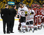 Bruce Irving (Harvard - Volunteer Assistant Coach), Albie O'Connell (Harvard - Assistant Coach), Luke Eibler (Northeastern - 20), Robbie Vrolyk (Northeastern - 91) - The Harvard University Crimson defeated the Northeastern University Huskies 3-2 in the 2012 Beanpot consolation game on Monday, February 13, 2012, at TD Garden in Boston, Massachusetts.