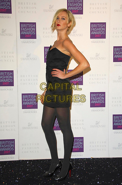 KIMBERLY STEWART.Arriving at the British Fashion Awards 2007 at the Horticulutral Hall London, Engalnd, .27th November  2007..full length black strapless dress hands on hips.CAP/CAS.©Bob Cass/Capital Pictures.