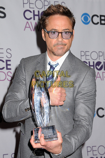 Robert Downey Jr..People's Choice Awards 2013 - Press Room held at Nokia Theatre L.A. Live, Los Angeles, California, USA..January 9th, 2013.half length blue white black grey gray shirt tie suit tinted glasses stubble facial hair award trophy winner hand thumb up.CAP/ADM/BP.©Byron Purvis/AdMedia/Capital Pictures.
