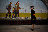 "A North Korean subway station staff waits for commuters at an underground station in Pyongyang, North Korea, Sunday, April 22, 2012. ""Inside DPRK"""