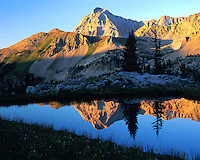 Sunset on Capital Peak reflected in a small pond deep in the Maroon Bells Wilderness, near Aspen, Colorado