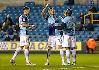 Adebayo Akinfenwa of Wycombe Wanderers celebrates his goal with Max Muller of Wycombe Wanderers during the Checkatrade Trophy round two Southern Section match between Millwall and Wycombe Wanderers at The Den, London, England on the 7th December 2016. Photo by Liam McAvoy.