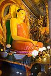 Large Buddha statue at Gangaramaya Temple, Colombo, Sri Lanka,