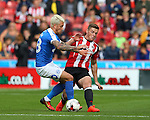 George Moncur of Peterborough Utd tussles with Jack O'Connell of Sheffield Utd during the League One match at Bramall Lane Stadium, Sheffield. Picture date: September 17th, 2016. Pic Simon Bellis/Sportimage