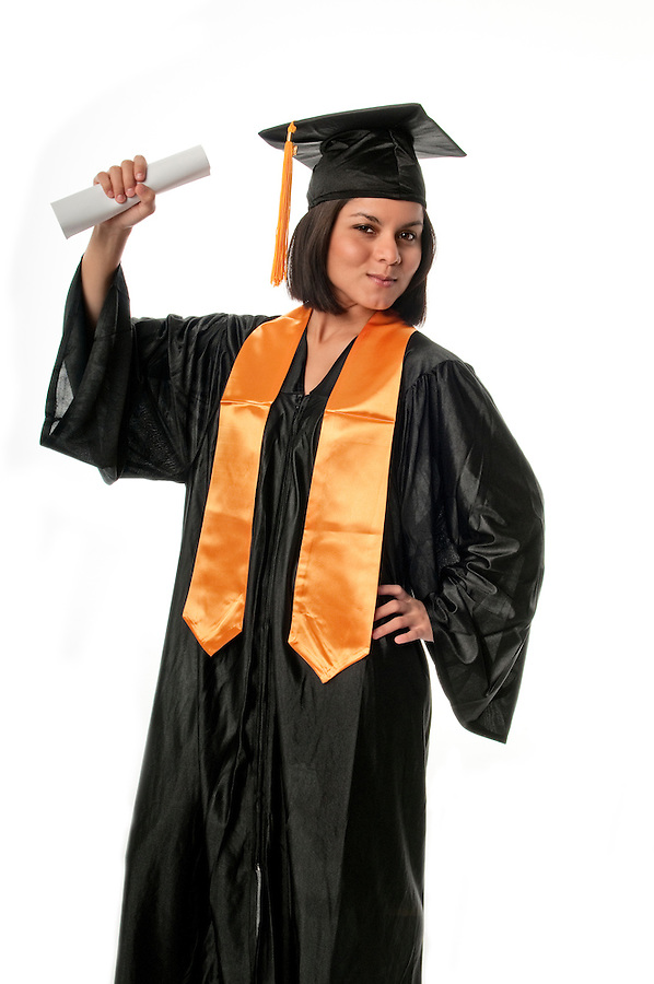 Portrait of young girl with graduation gown and diploma.