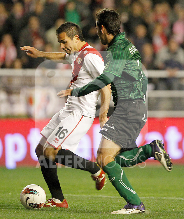 Rayo Vallecano's Emiliano Daniel Armenteros (l) and Betis' Jose Antonio Dorado during La Liga match.March 17,2012. (ALTERPHOTOS/Acero)