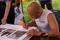"""ARCADIA, CA  JUNE 23: Mike Smith signing the Justify Triple Crown poster on  """"Justify Day"""" on June 23, 2018 at Santa Anita Park in Arcadia, CA.  (Photo by Casey Phillips/Eclipse Sportswire/Getty Images)"""