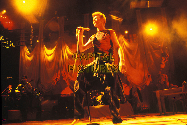 DAVID BOWIE.In concert.8th December 1993.full length stage gig music black sleeveless top trousers baggy microphone.www.capitalpictures.com.sales@capitalpictures.com.©Capital Pictures