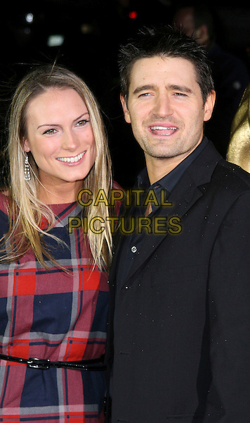 CLARE & TOM CHAMBERS .British Academy Children's Film and Television Awards at the London Park Lane Hilton, Park Lane, England, UK, November 30th 2008..BAFTA BAFTA's half length red plaid dress black suit jacket claire belt .CAP/JIL.©Jill Mayhew/Capital Pictures