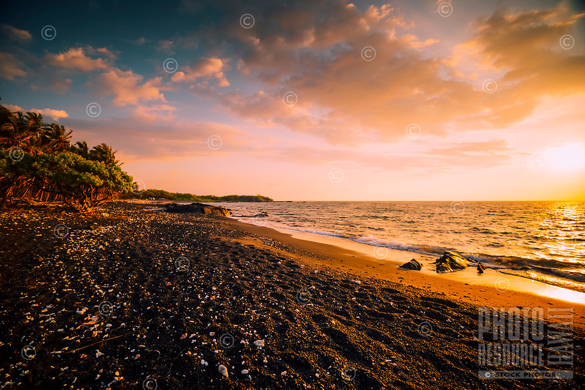 A camping beach lit by the setting sun, Kailua-Kona, western Hawai'i Island.