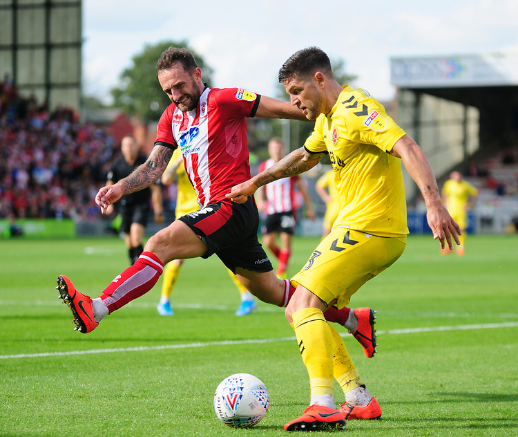 Lincoln City's Neal Eardley battles with  Fleetwood Town's Danny Andrew<br /> <br /> Photographer Andrew Vaughan/CameraSport<br /> <br /> The EFL Sky Bet League One - Lincoln City v Fleetwood Town - Saturday 31st August 2019 - Sincil Bank - Lincoln<br /> <br /> World Copyright © 2019 CameraSport. All rights reserved. 43 Linden Ave. Countesthorpe. Leicester. England. LE8 5PG - Tel: +44 (0) 116 277 4147 - admin@camerasport.com - www.camerasport.com
